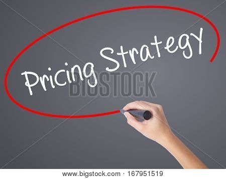 Woman Hand Writing Pricing Strategy With Black Marker On Visual Screen.