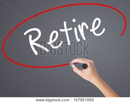 Woman Hand Writing Retire With Black Marker On Visual Screen