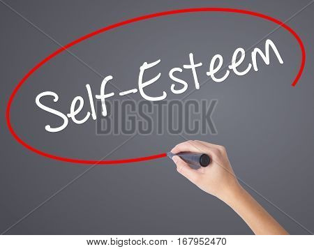 Woman Hand Writing Self-esteem With Black Marker On Visual Screen.
