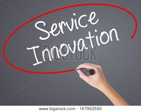 Woman Hand Writing Service Innovation With Black Marker On Visual Screen.