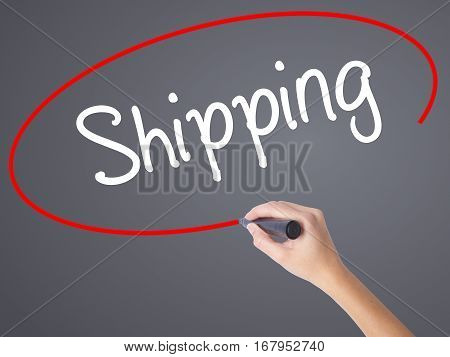Woman Hand Writing Shipping With Black Marker On Visual Screen.