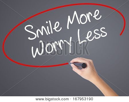 Woman Hand Writing Smile More Worry Less With Black Marker On Visual Screen