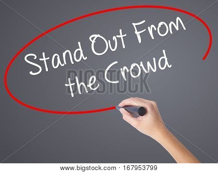 Woman Hand Writing Stand Out From The Crowd With Black Marker On Visual Screen
