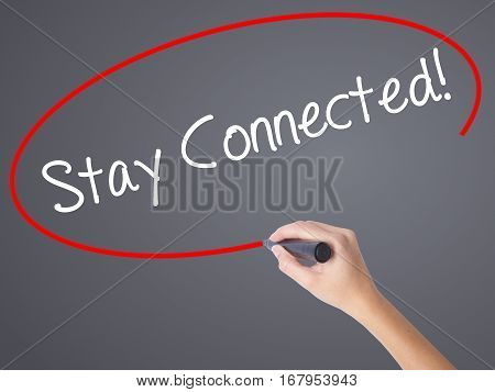 Woman Hand Writing Stay Connected! With Black Marker On Visual Screen