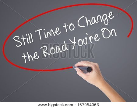 Woman Hand Writing Still Time To Change The Road You're On With Black Marker On Visual Screen