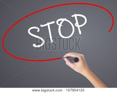 Woman Hand Writing Stop With Black Marker On Visual Screen.