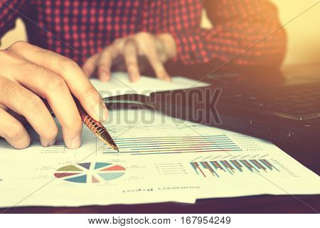 Close Up Businessman Hand Writing With Calculating At Home Office.