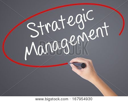 Woman Hand Writing Strategic Management With Black Marker On Visual Screen.