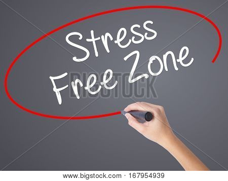 Woman Hand Writing Stress Free Zone With Black Marker On Visual Screen