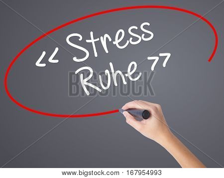 Woman Hand Writing Stress Ruhe  (stress - Peacein German) With Black Marker On Visual Screen.