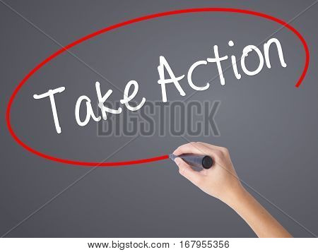 Woman Hand Writing Take Action With Black Marker On Visual Screen