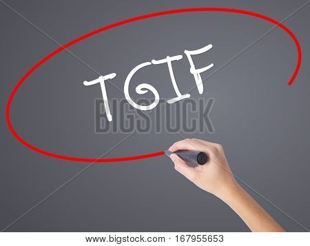 Woman Hand Writing Tgif With Black Marker On Visual Screen