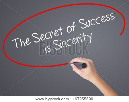 Woman Hand Writing The Secret Of Success Is Sincerity With Black Marker On Visual Screen.