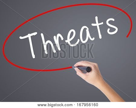 Woman Hand Writing Threats With Black Marker On Visual Screen
