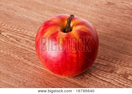 red apple on wooden texture