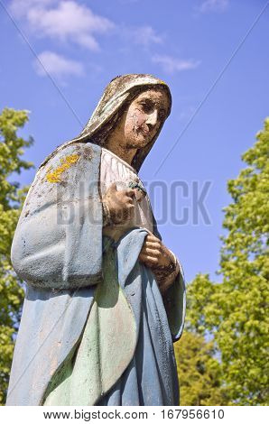 old vintage sculpture of St. Mary fragment