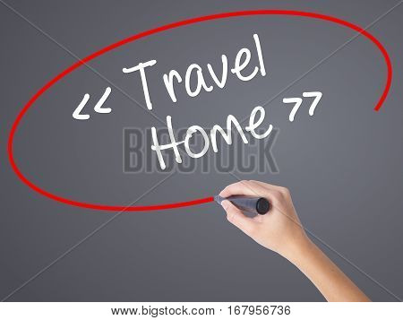 Woman Hand Writing Travel - Home With Black Marker On Visual Screen