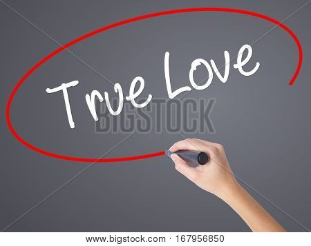 Woman Hand Writing True Love With Black Marker On Visual Screen