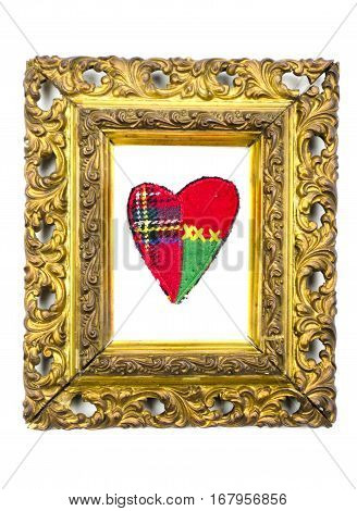 antique golden art frame with cloth heart isolated on white
