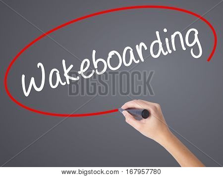 Woman Hand Writing Wakeboarding With Black Marker On Visual Screen.