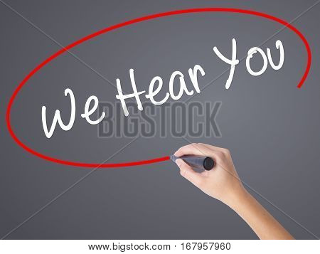 Woman Hand Writing We Hear You With Black Marker On Visual Screen
