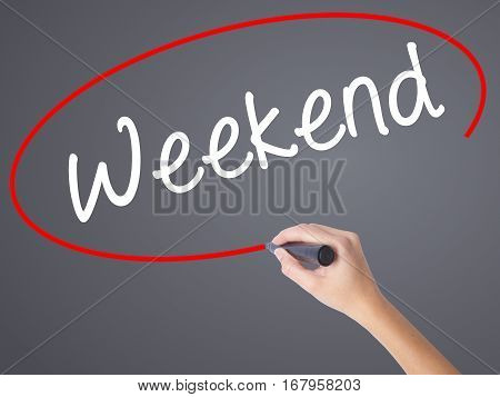 Woman Hand Writing Weekend With Black Marker On Visual Screen