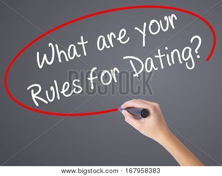 Woman Hand Writing What Are Your Rules For Dating?  With Black Marker On Visual Screen