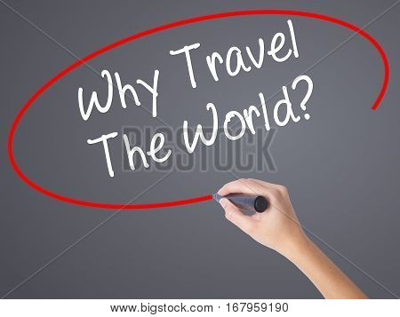 Woman Hand Writing  Why Travel The World? With Black Marker On Visual Screen