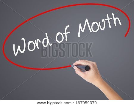 Woman Hand Writing Word Of Mouth  With Black Marker On Visual Screen