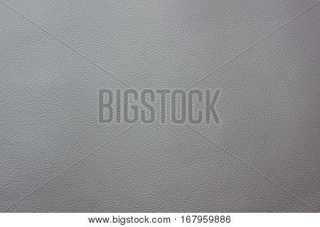 Gray leather texture closeup background. Structured background design nubuk