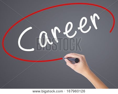 Woman Hand Writing Career With Marker On Transparent Wipe Board
