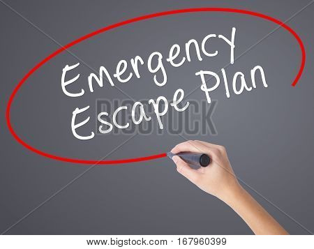 Woman Hand Writing Emergency Escape Plan With Black Marker On Visual Screen