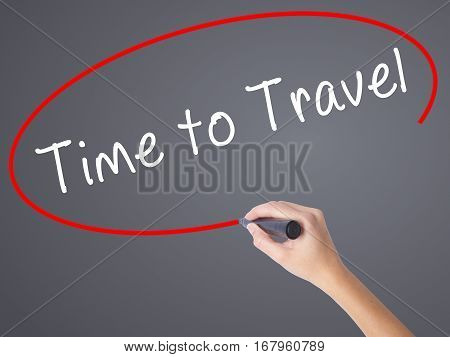 Woman Hand Writing Time To Travel With Black Marker On Visual Screen