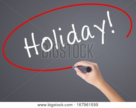 Woman Hand Writing Holiday! With Black Marker On Visual Screen