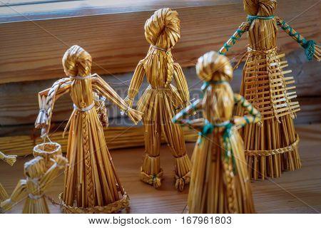Straw doll. Vintage children's toys handmade from dried straw for rural children.