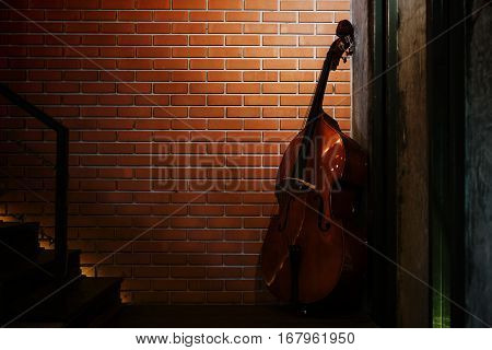 Cello Near Brick Wall And Stair, Classic Interior