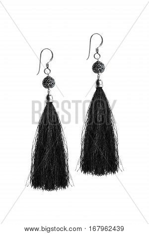 Black silk tassel earrings on white background