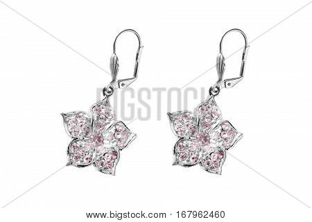 Pink crystals silver earrings isolated over white