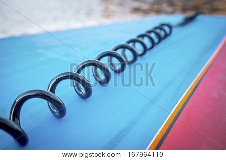 coil leash on a deck of stand up paddleboard - safety equipment,