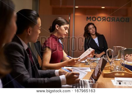 Female boss chairing business meeting in boardroom, close up