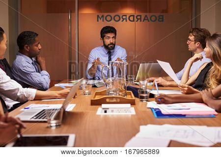Business people listening to manager at a meeting, close up
