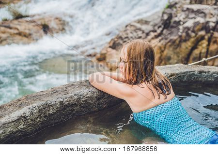 Geothermal Spa. Woman Relaxing In Hot Spring Pool Against The Background Of A Waterfall