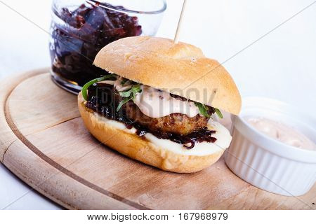 Hamburger with onion chutney and cheese