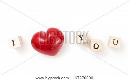 Red heart and wooden cubes with I and You on white background. I love you concept.