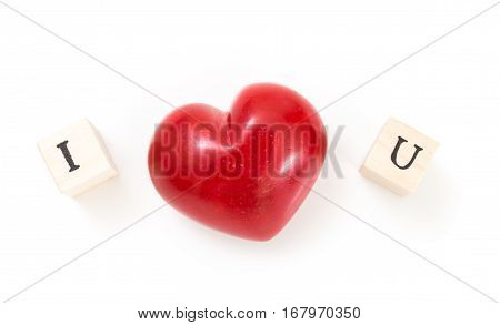 Red Heart And Wooden Cubes With I And U, On White Background. I Love You Concept.