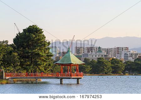 the eight-sided tower jutting out into the pond at Fukuoka Ohori Park Japan