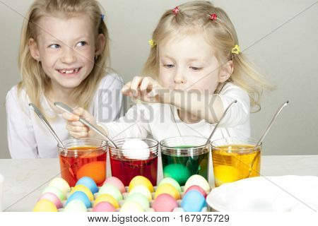 little girls during Easter eggs'' coloration