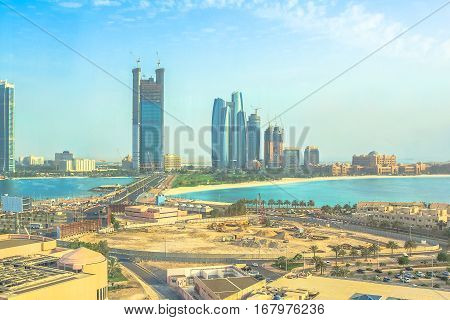 Aerial view of Abu Dhabi skyline from popular tourist attraction of Marina Mall Tower, an observatory above the Marina Shopping Mall. Urban cityscape Abu Dhabi, United Arab Emirates, Middle East.