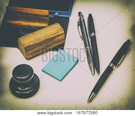 office accessories pen seal stamp paper for notes on a white background authentic retro style