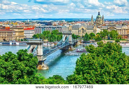 Chain bridge on Danube river in Budapest city. Hungary. Urban landscape panorama with old buildings and domes of opera